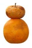 Overripe apple and orange over white background Stock Photos