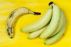 Overripe banana and green Royalty Free Stock Photos