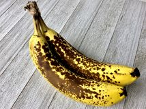Overripe bananas. On a white background stock image