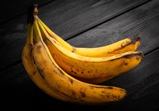 Overripe spotted bananas. On dark background royalty free stock image