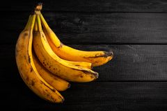 Overripe spotted bananas. On dark background royalty free stock photo