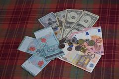 Overseas currency - Colour of Money!. Dollars, Euros and Ringgits can help you wade airport duty-free shops and enjoy a shopping spree! Moreover, money helps us Stock Photo