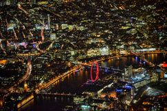 Overshot of London including londoneye house of parliament bridge. Flight shot of London at night time Royalty Free Stock Image