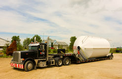 An oversize load arriving at a farm in canada Stock Image