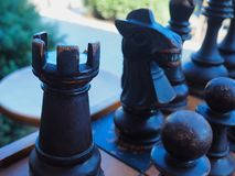 Oversize Rook and Knight in Chess Set. An oversize chess set focusing on the black rook and knight, with pawns as well royalty free stock photography