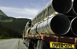 Oversize trailer. With big metal tubes royalty free stock photos