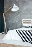 Lamp in dark bedroom Stock Images