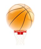 Oversized basketball ball over hoop Stock Photos