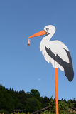 Oversized birth stork wooden stock photography