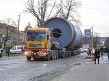 Oversized Cargo Transportation. Burshtyn, Ivano-Frankivsk region, Ukraine - 12 December 2017 : Trailer truck of the company `Ukrtransalliance` carries oversized Royalty Free Stock Photos