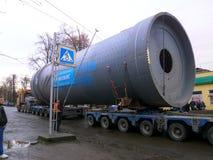 Oversized Cargo Transportation. Burshtyn, Ivano-Frankivsk region, Ukraine - 12 December 2017 : Trailer truck of the company `Ukrtransalliance` carries oversized Stock Photos