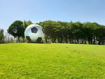 Oversized football as an artwork in public space stock image