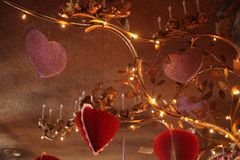 Oversized golden chandelier with Valentine& x27;s Day heart decorations at the Madonna Inn. San Luis Obipso favorite Madonna Inn dresses up their restaurant Royalty Free Stock Photos