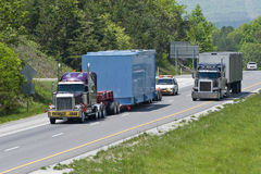 Oversized Load Heading Down Highway Stock Image