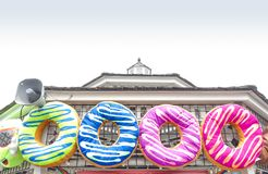 Oversized plush donut prizes at amusement park family midway carnival games. Fun toy donut prizes at amusement park arcade games win Royalty Free Stock Image