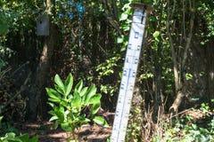 Oversized quicksilver thermometer in the blazing sun Stock Photo