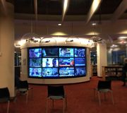 Oversized television screen inside Toronto Reference public library Stock Photo