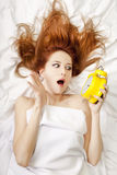 Oversleep girl in bed Stock Photos