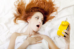 Oversleep girl in bed Royalty Free Stock Photo
