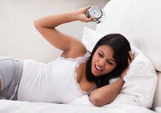 Overslept Woman Looking At Alarm Clock Stock Photos