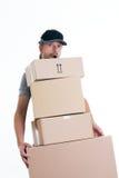 Overspannen brievenbesteller met pakketten Stock Fotografie