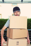 Overstrained postman with parcels Stock Photos