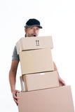 Overstrained postman with parcels Stock Photography