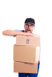 Overstrained postman with parcels Royalty Free Stock Image