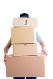 Overstrained postman with parcels Royalty Free Stock Photos