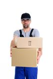 Overstrained postman with parcels Stock Photo