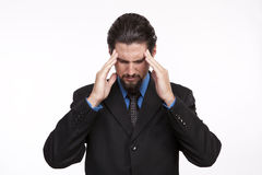 Overstressed businessman suffering from headache Stock Photo