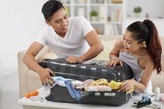 Overstuffed suitcase Stock Image