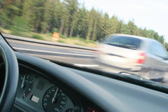 Overtaking. A blurred car overtaking another on the highway Stock Images