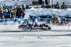 Overtaking on a bend. Russia. The Republic Of Bashkortostan. The Ufa. Racing on ice. The Championship Of Russia. A final . February 1, 2014 Stock Photography
