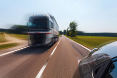 Overtaking truck, motion blur. Good weather conditions, rear view from passengers seat Royalty Free Stock Photography