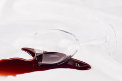 Overthrow glass of wine Stock Images
