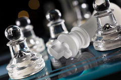 Overthrown King On Blue Chessboard With Crooked Angle And Bokeh Royalty Free Stock Photos