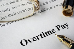 Overtime pay concept Stock Image