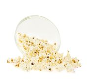 Overturn bowl of popcorn isolated. Over the white background Stock Images