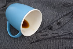 The overturned blue cup Stock Photography