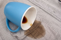 The overturned blue cup Stock Image