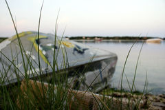 Overturned boat on the beach. Graffiti ridden boat on the beach Royalty Free Stock Photos