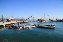 Overturned boat migrants Stock Photo