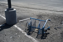Overturned broken shopping cart Royalty Free Stock Image
