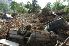 Overturned car amid the wreckage after mudslides Stock Photos