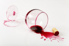 Overturned glass of wine. Overturned glass , poured wine and stains Royalty Free Stock Photography