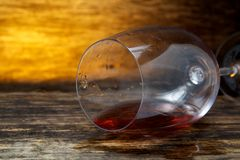 Overturned glass of wine on floor Royalty Free Stock Photography