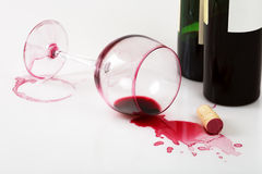 Overturned glass and wine stains. Wine bottles, overturned glass and wine stains Stock Photography