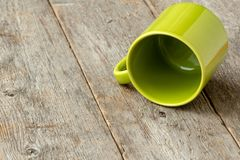Overturned green cup royalty free stock photography