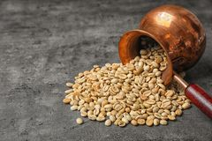 Free Overturned Jezve With Green Coffee Beans Royalty Free Stock Photo - 131008595
